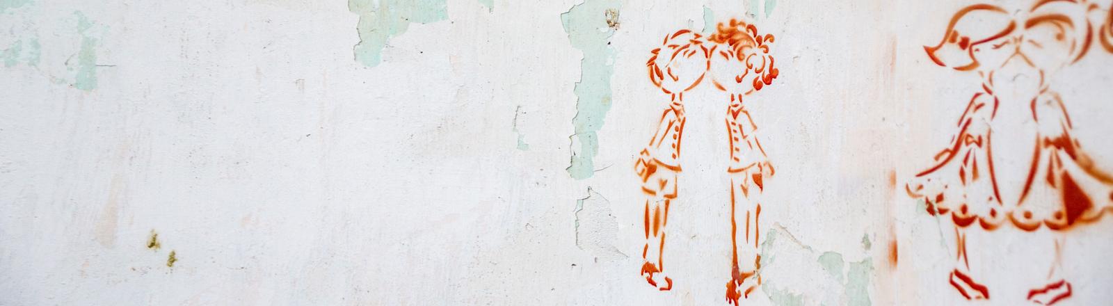 Kindheit - gemalte Kinder auf einer Wand.
