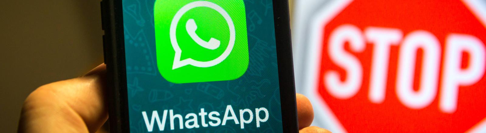 Whatsapp-Symbol und Stopp-Zeichen