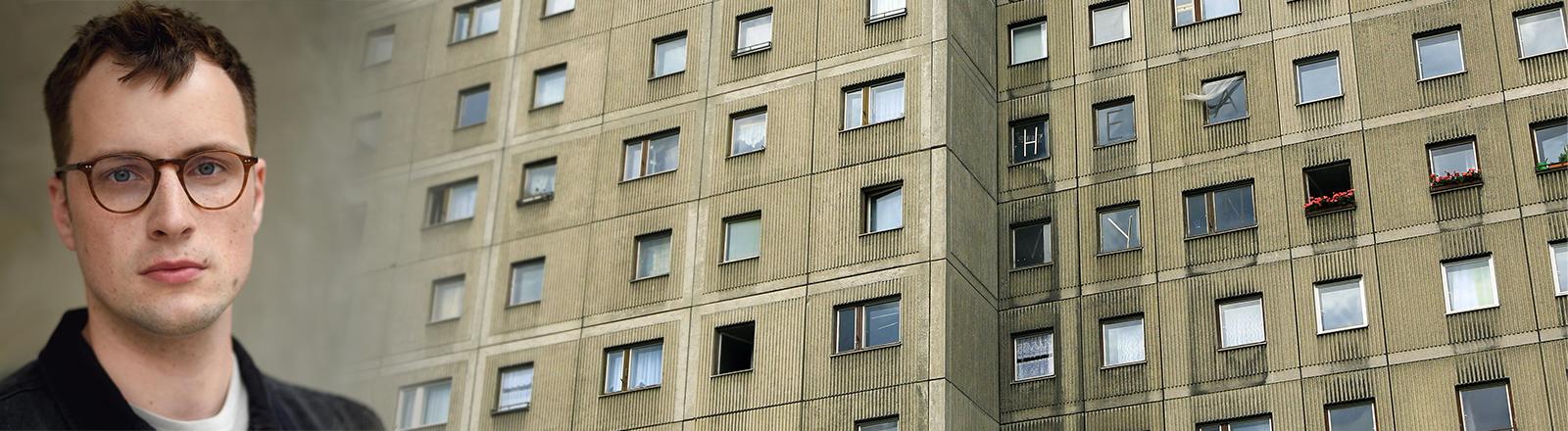Portrait von Johannes Nichelmann vor einer Plattenbau-Fassade