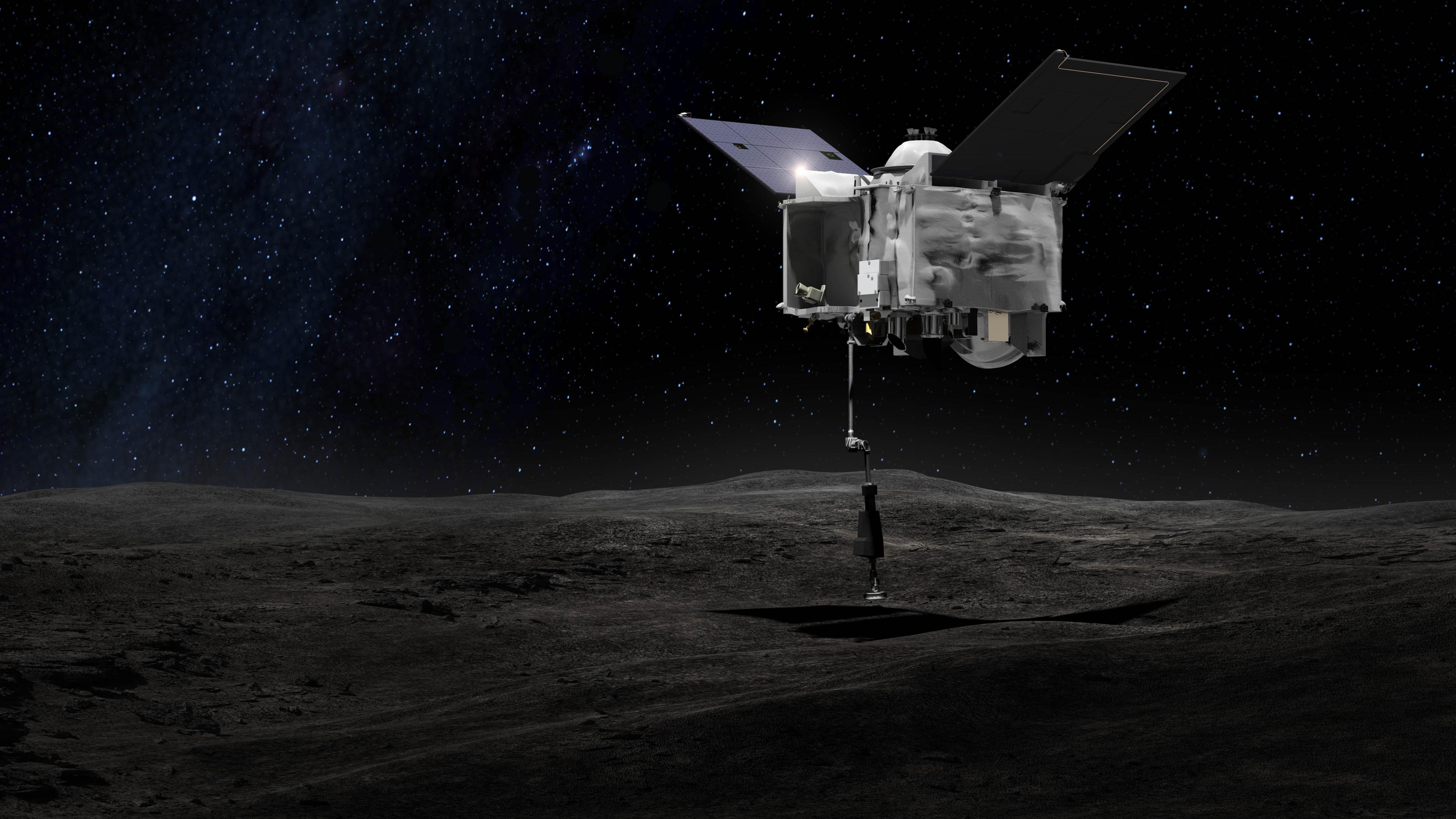 Eine undatierte grafische Darstellung zeigt die Nasa-Sonde Osiris-Rex, die über dem Asteroiden Bennu mit ihrem Touch-And-Go Sample Arm Mechanism (TAGSAM), einer Art Roboter-Arm, eine Probe von dem Asteroiden nimmt.