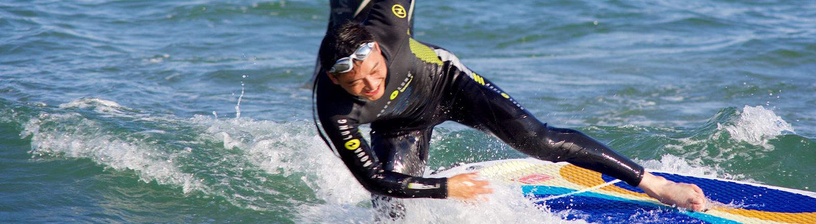 Surfer auf einem Board