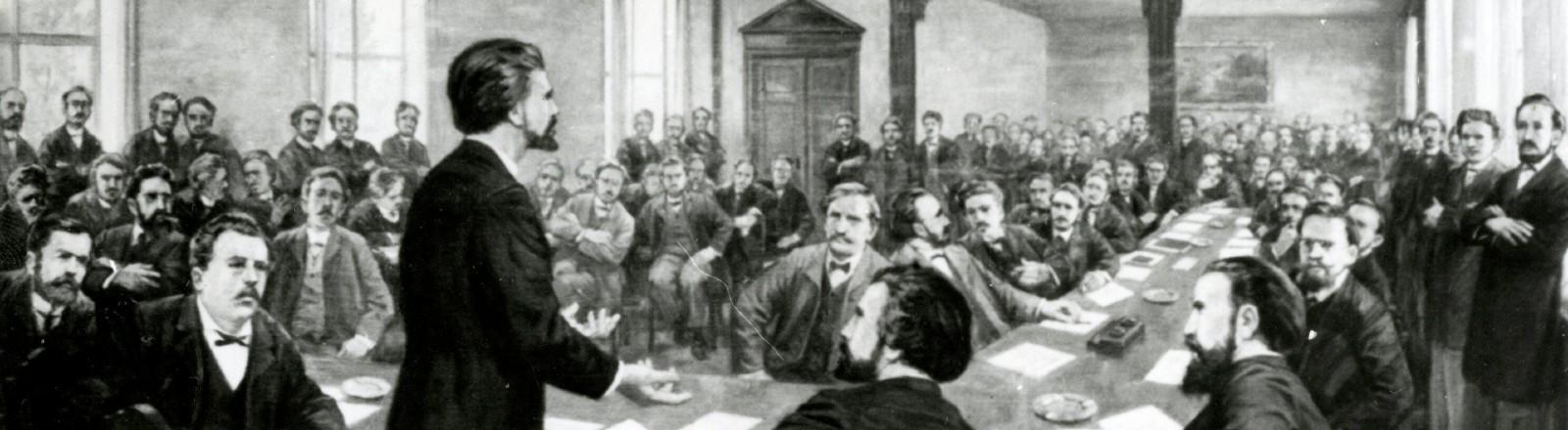 Gründung der SAP 1875. Eine Zeichnung mit vielen Männern in einem Saal.