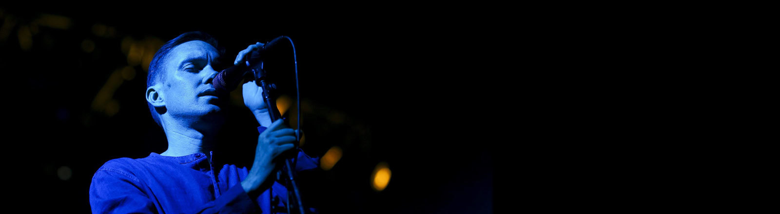 Canadian singer Mike Milosh of US musical group 'Rhye' performs during a concert at the Super Bock Super Rock Festival in Lisbon, Portugal, 15 July 2016. The festival runs from 14 to 16 July.