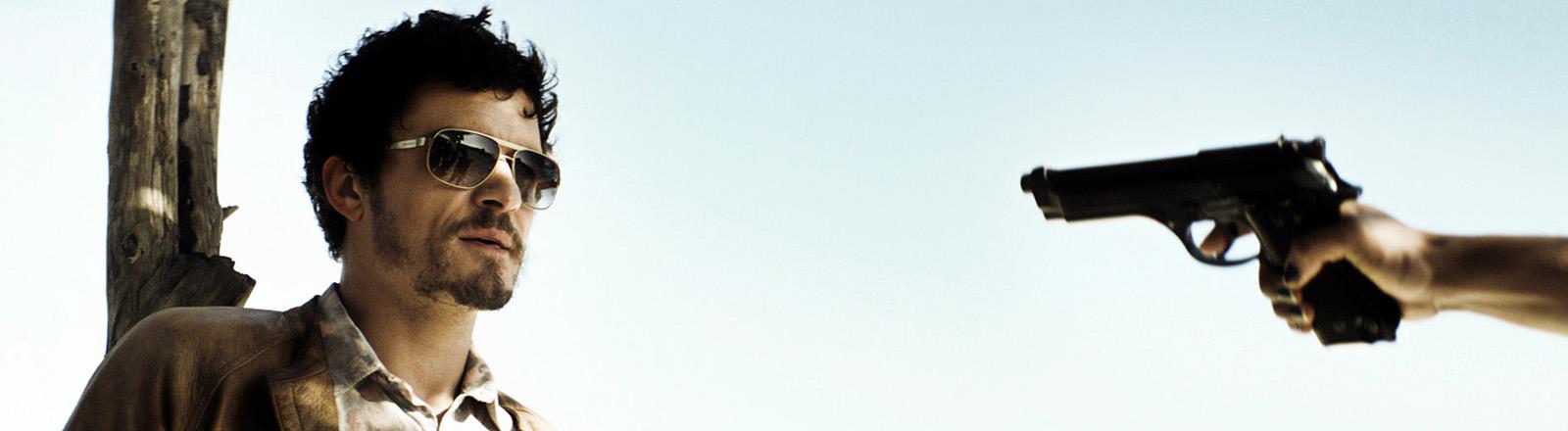"""Orlando Bloom als Brian Epkeen in einer Szene des Kinofilms """"Zulu""""."""