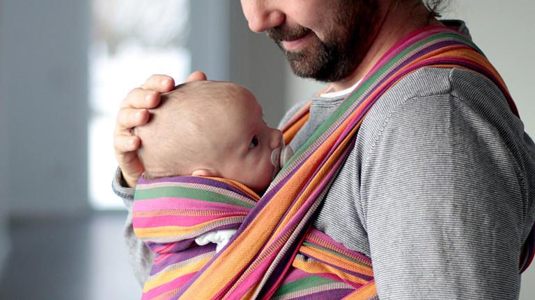 Mann mit Baby