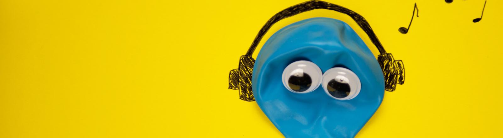 Blauer Luftballon mit Augen und Kopfhörern