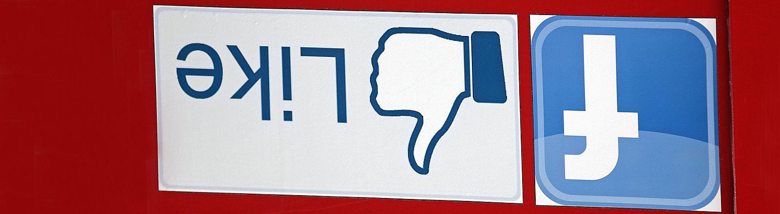 """Der Facebook-Daumen """"I like"""" zeigt in die entgegengesetzte Richtung."""