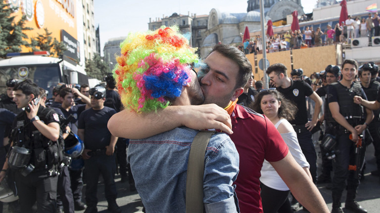 Two men demonstrative kiss each other in front of a group of Turkish riot police officers during a rally on the occasion of the 13th annual Gay Pride Parade in Istanbul, Turkey, 28 June 2015