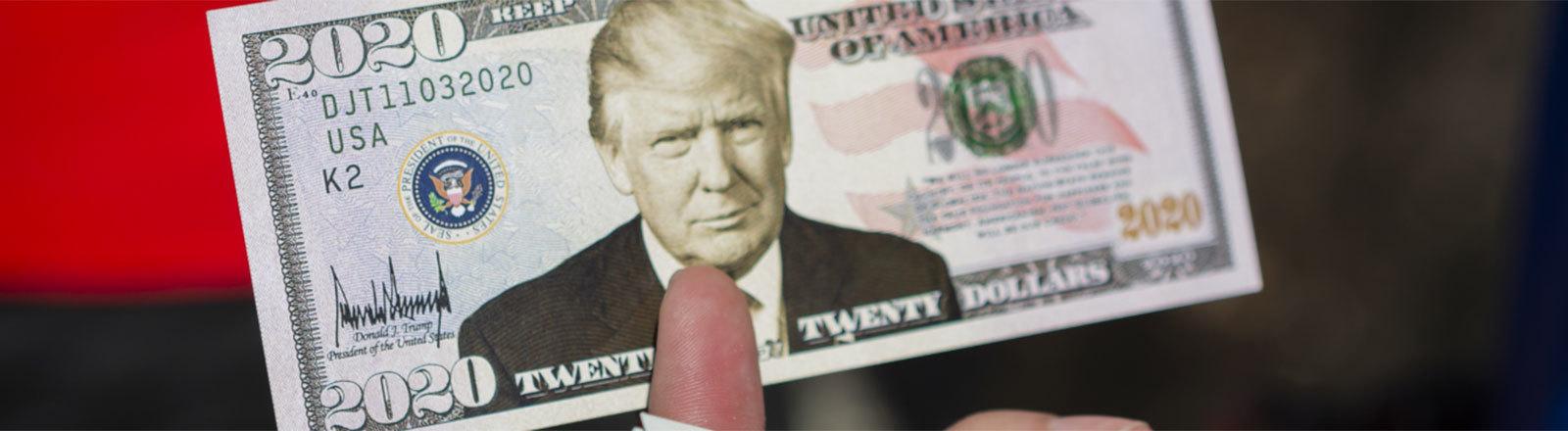 Eine Geldnote mit dem Konterfei Donald Trumps