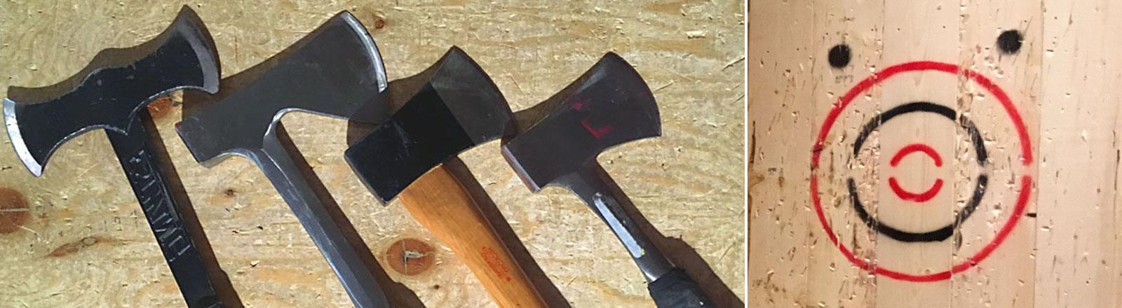 Vier Äxte liegen nebeneinander, daneben eine Zielscheibe aus Holz