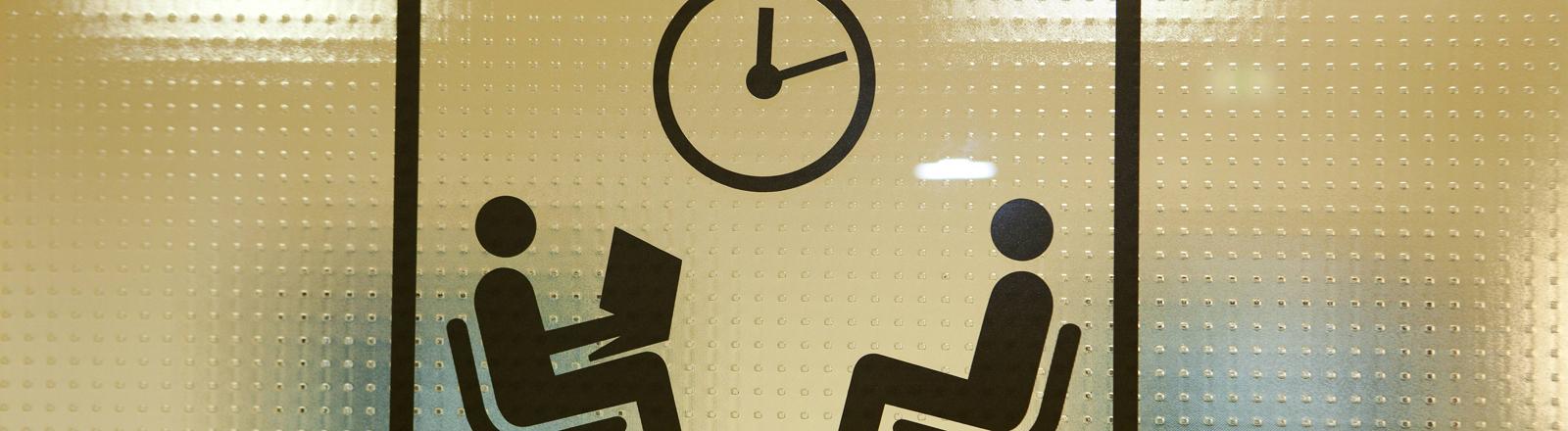 Wartezimmersymbol auf einer Glastüre