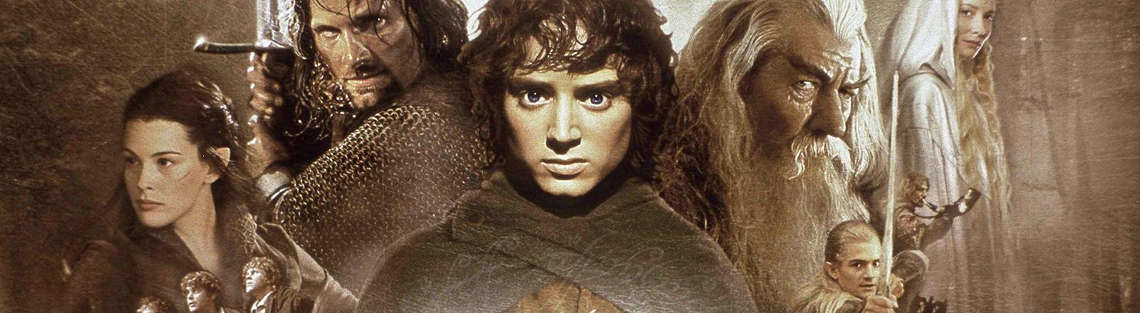 """Das Filmplakat zu """"Herr der Ringe"""" zeigt die Helden, in ihrer Mitte der Hobbit Frodo."""