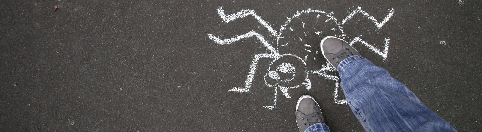 Kreidespinne auf der Straße