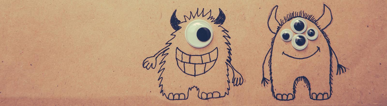 Zwei Monster mit Augen.