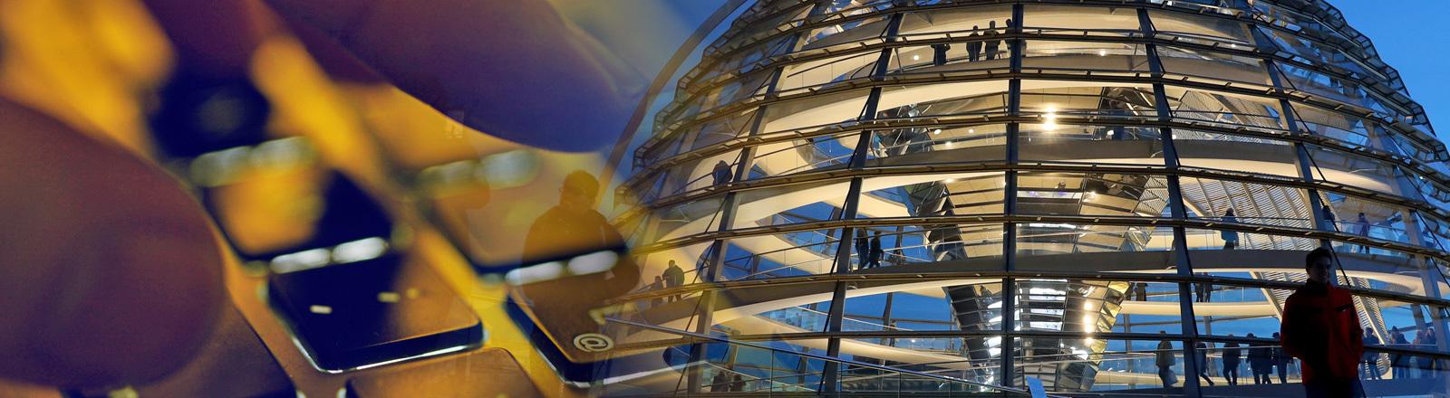 Tippen auf der Tastatur und die Reichstagskuppel in Berlin.