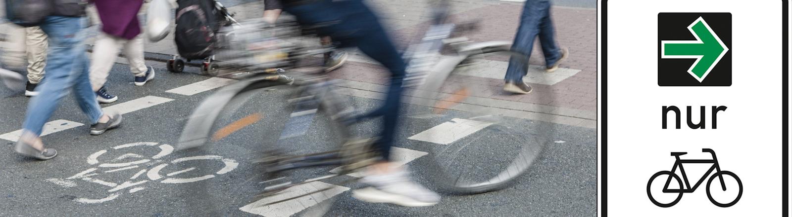 Grünpfeil Schild und Verkehrsteilnehmer