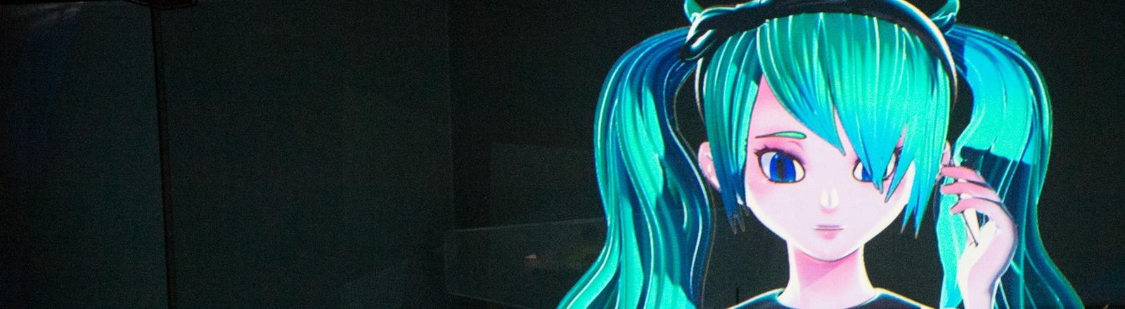 """Die computeranimierte Sängerin Hatsune Miku ist am 18.08.2016 in Hamburg während der Fotoprobe der Oper """"The End"""" auf der Leinwand zu sehen. Die Musik für das Stück komponierte Keichiiro Shibuya. Die Deutsche Erstaufführung findet am 18.08. statt. Foto: Daniel Reinhardt/dpa"""