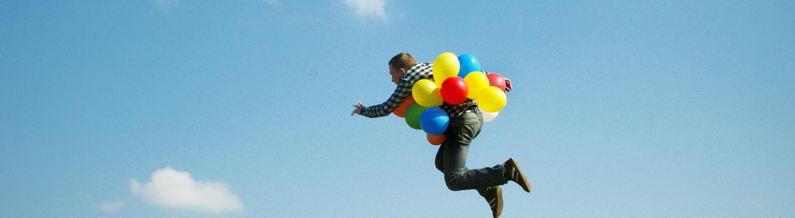 Mann mit Ballons