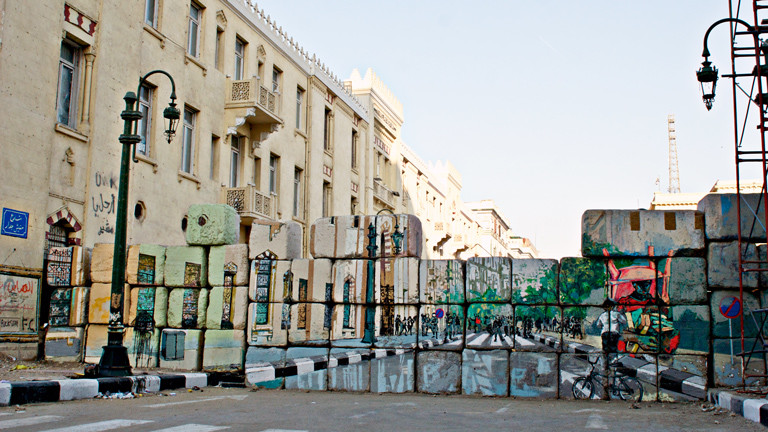 "The ""No Walls"" campaign is an attempt by artists to create a tromp l'oeil effect on barrier walls constructed by the military to impede protesters."