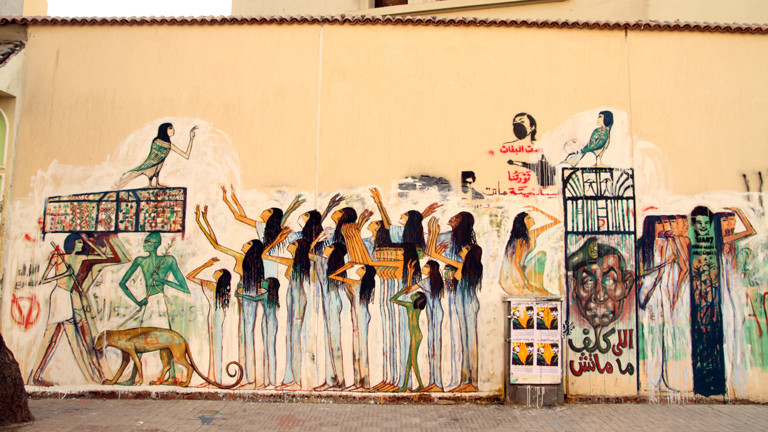 Mourning mural inspired by the Ancient Egyptian Tomb or Ramose, Mourning 70 football spectators who died in Feb. 2012