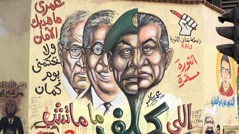 A mural showing Tantawy/Mubarak and two presidential candidates that served during Mubarak Era.
