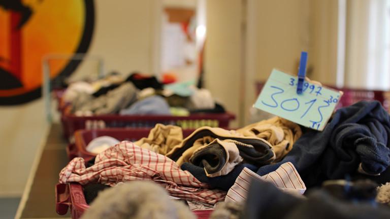 Bild und Szene aus der Wäscherei, die Lidia aufgebaut hat