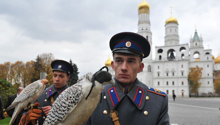 Military servicemen holding two white gyrfalcons, confiscated from smugglers by customs officers at Domodedovo airport in 2010, after the transfer ceremony of the two birds to the service of the Moscow Kremlin. Alexey Kudenko/RIA Novosti