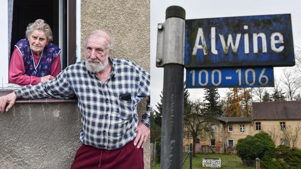 Zwei Bewohner des Örtchens Alwine und ein Straßenschild auf dem Awine steht.