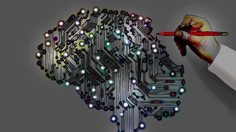 Symbolgild für Künstliche Intelligenz - ein Kopf mit markierten Punkten.
