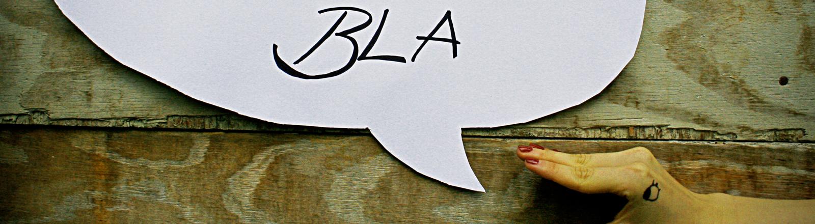 """Eine Sprechblase, in der """"bla"""" steht."""