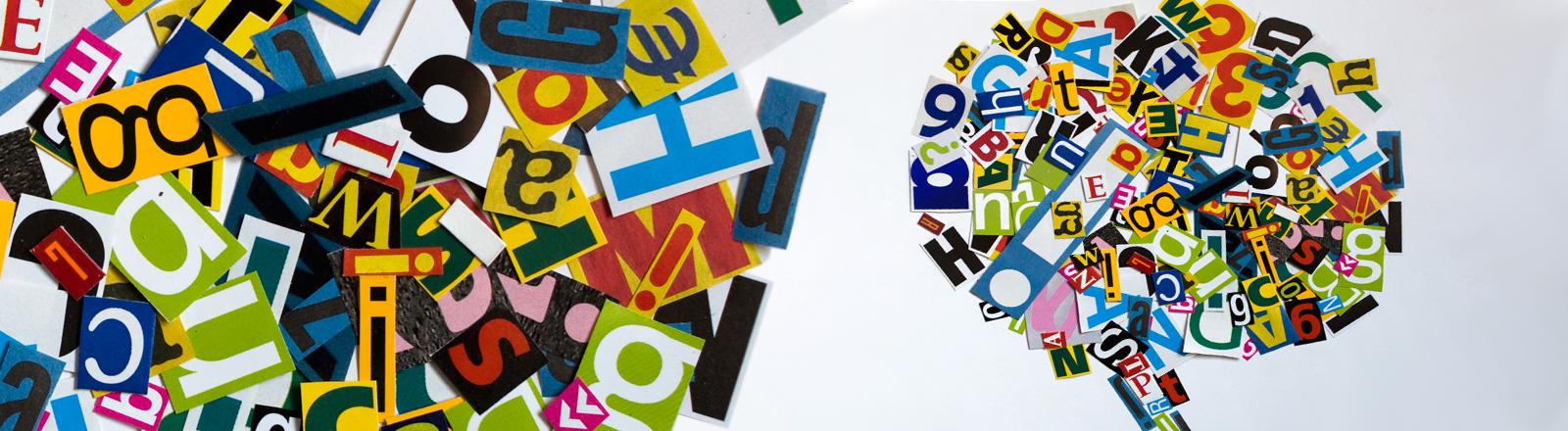 bunte Buchstaben, angeordnet in der Form einer Sprechblase