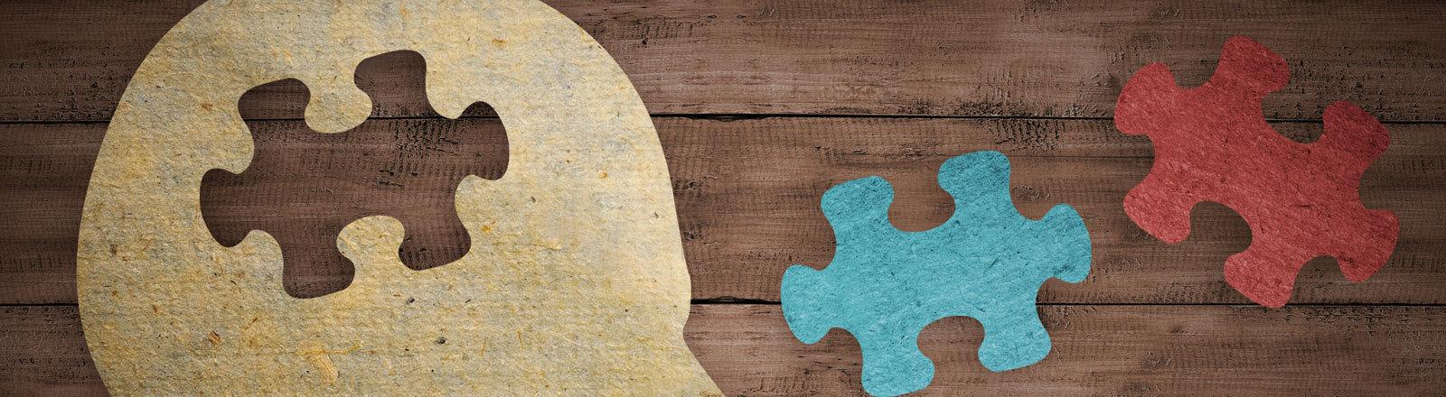 Symbolbild: Ein Kopf mit fehlendem Puzzlestück.