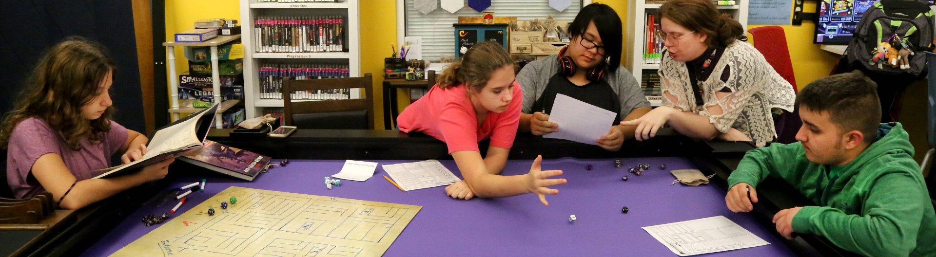 October 17, 2019, Palm Harbor, Florida, USA: From left: Justine Miller, 13, Rebecca Miller, 13, Ty Tran, 14, Samma Fagan (librarian) and Jarod Layliev, 15, (all) of Palm Harbor, play a game of Dungeons & Dragons at the new Mark Mazurek Gaming Center