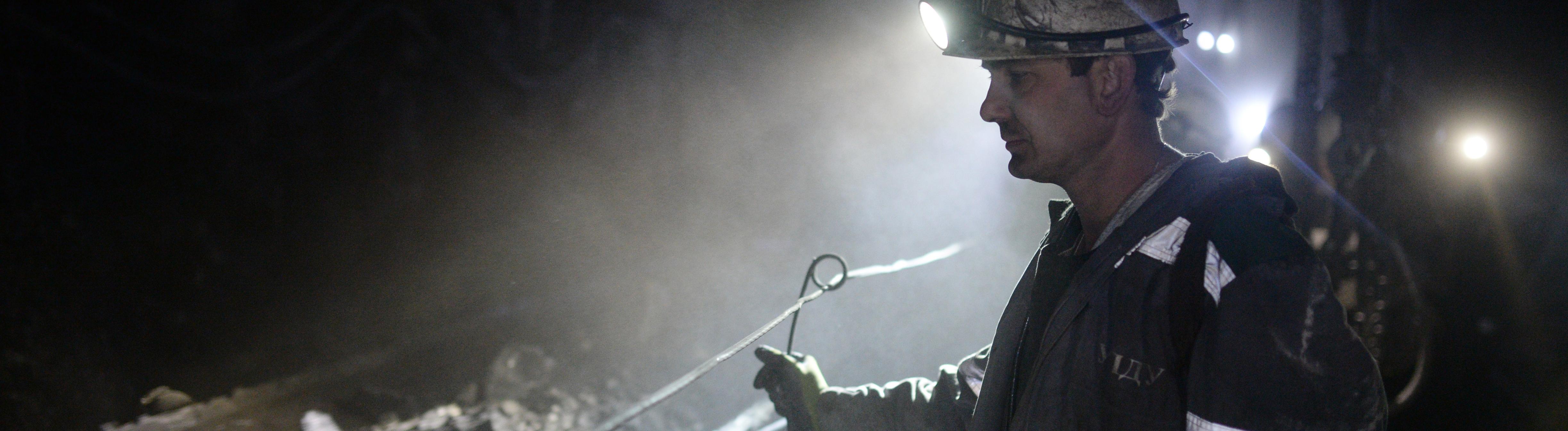 A miner of Sibirginskaya mine developed by Yuzhny Kuzbass company, part of Mechel Mining.mine, coal, extraction, excavator, dump truck Alexandr Kryazhev