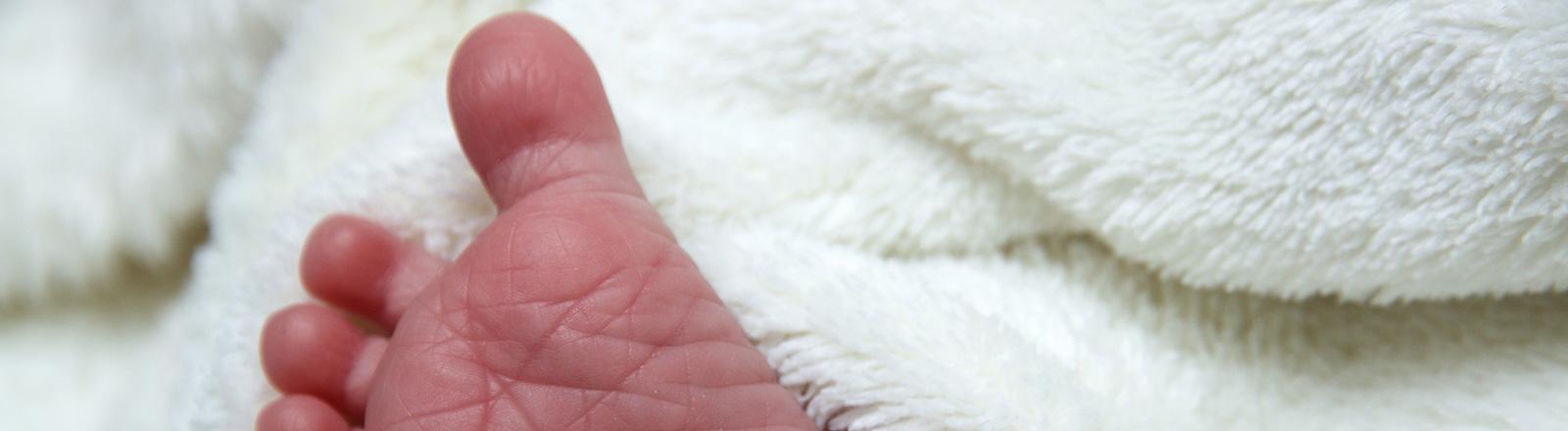 Fuß eines Neugeborenen