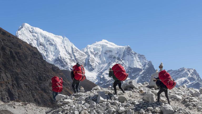Nepal, Himalaya, Khumbu, Everest region, Porters on Ngozumpa glacier