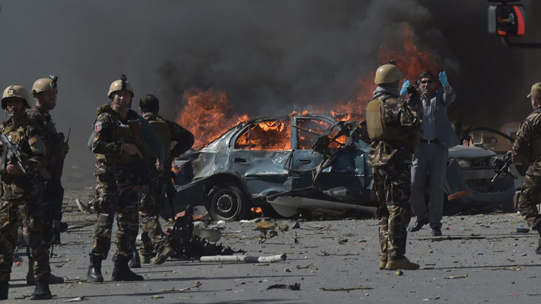 Afghan security forces personnel are seen at the site of a car bomb attack in Kabul on May 31, 2017. At least 40 people were killed or wounded on May 31 as a massive blast ripped through Kabul's diplomatic quarter, shattering the morning rush hour and bringing carnage to the streets of the Afghan capital.