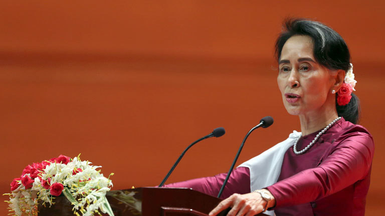 Myanmar's State Counsellor Aung San Suu Kyi delivers a televised speech to the nation at the Myanmar International Convention Center in Naypyitaw, Myanmar, Tuesday, Sept. 19, 2017. Suu Kyi said Tuesday that most Rohingya villages weren't hit by violence. She invited foreign diplomats gathered in the capital for her speech to visit villages that were unaffected.