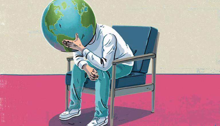 Ein Mann, dessen Kopf ein Globus ist, sorgt sich um den Zustand der Welt.