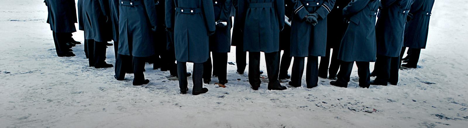 Eine Gruppe von Männern in Frack.