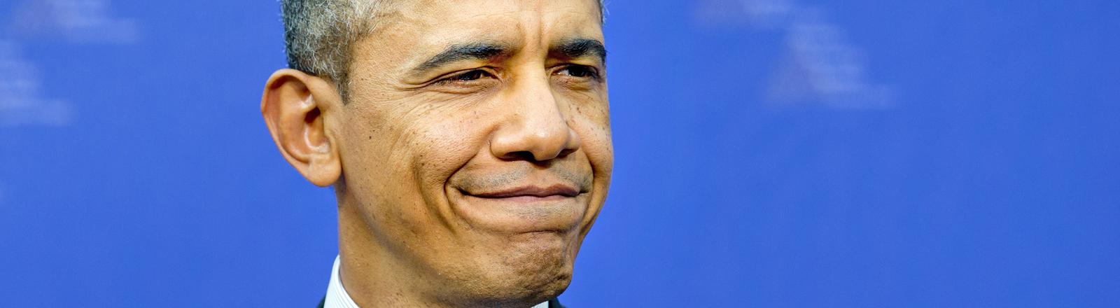 Barack Obama schneidet eine Grimasse