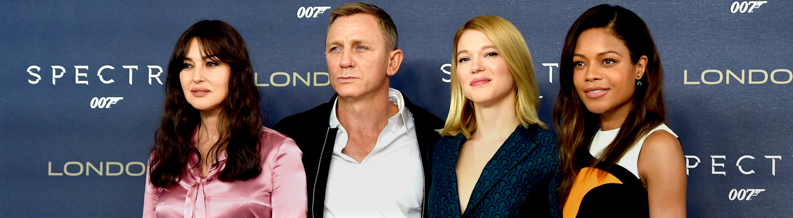 Italian actress Monica Bellucci, British actor Daniel Craig, French actress Lea Seydoux and British actress Naomi Harris pose for photographers during a photocall to unveil the new James Bond film 'Spectre' at a hotel in Central London