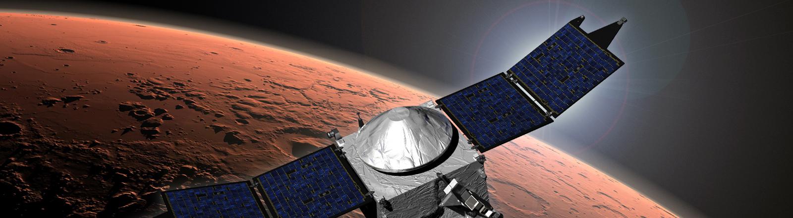 """Eine grafische Darstellung zeigt die US-Forschungssonde """"Maven"""" im Orbit des Mars."""