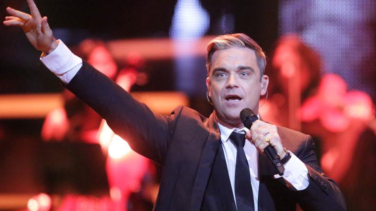 Sänger Robbie Williams bei einem Auftritt.