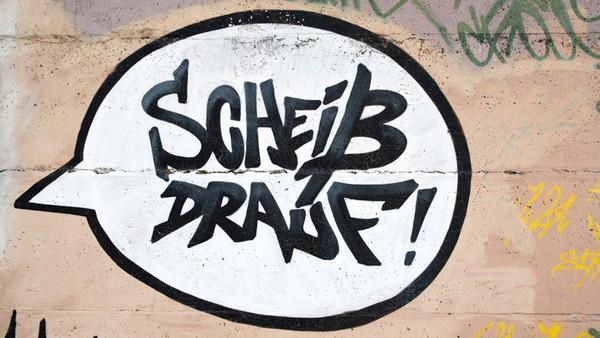 Graffiti: Sprechblase in der steht: Scheiß drauf!