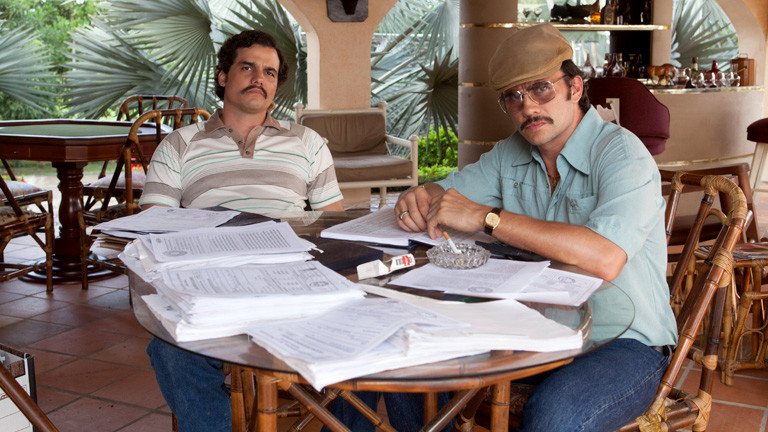 Brazilian actor Wagner Moura as Pablo Escobar and Colombian actor Juan Pablo Raba as Gustavo in the Netflix Original Series NARCOS