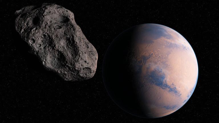 Symbolbild: Asteroid und Planet