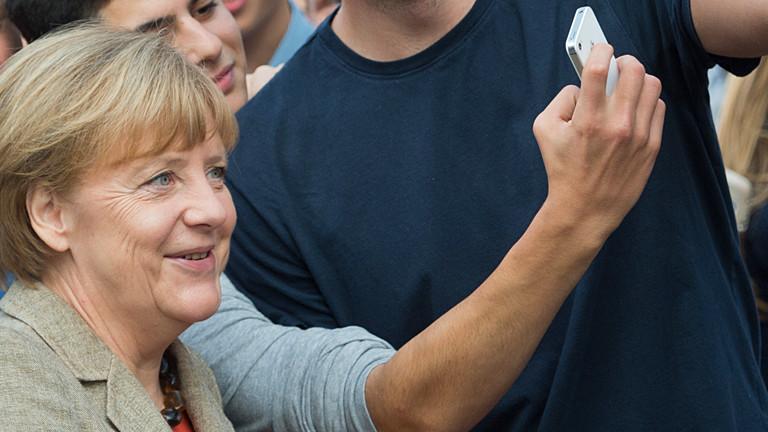 Merkel macht ein Selfie