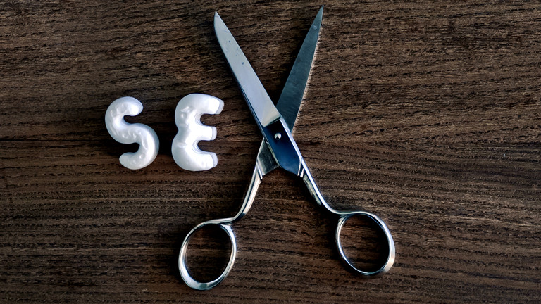 Eine Schere symbolisiert das X in Sex