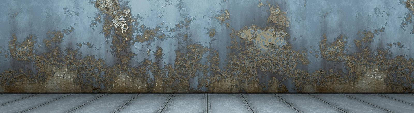 Eine Wand mit Schimmelflecken